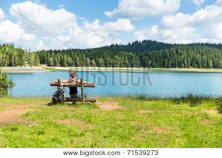 Traveler woman rests on the bench