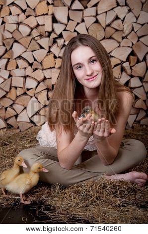 Cute girl with duckling has easter