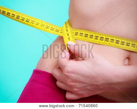 Fit Girl With Measure Tape Measuring Her Waist