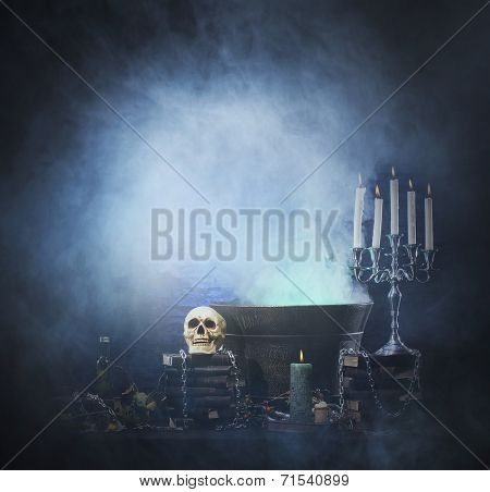 Halloween background with a lot of different witchcraft tools: scull, candles, book, poison and smoke