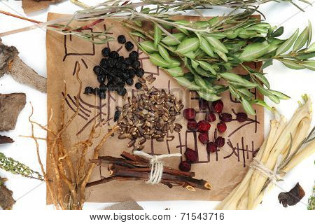 Traditional chinese herbal medicine ingredients with not real hieroglyphs, close-up