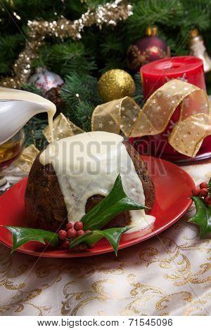 Christmas Pudding With White Sauce