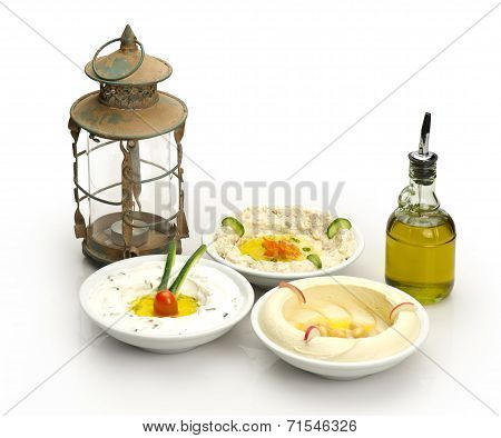 Arabic traditional Hummus , labneh and mtabbal with Ramadan Lamp