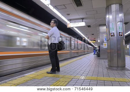 Japanese business man at station