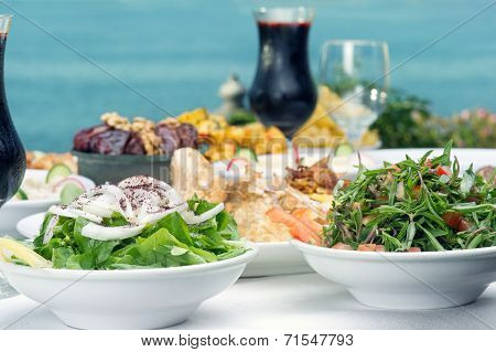 Lebanese food presentation of rucola, thyme Salad, and Jalleb served in Ramadan.