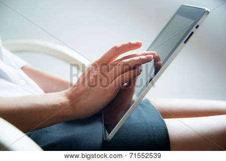 Woman using a tablet computer. Close up.