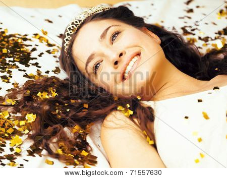 beauty young girl in gold confetti and tiara, little princess celebration