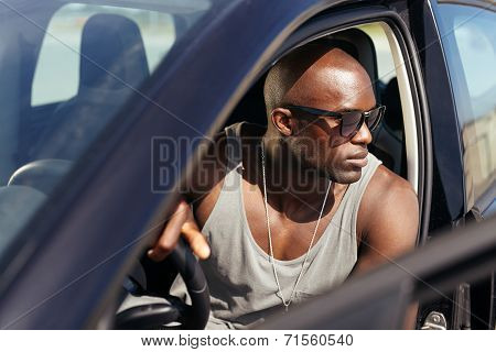 Handsome Young Man Sitting In His Car