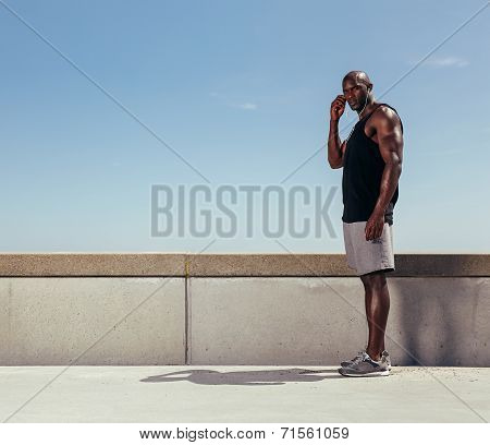 Fit Young Man Standing On A Walkway