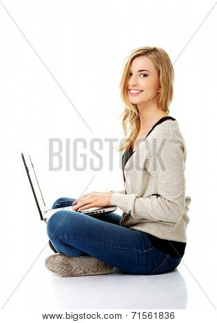 Smiling young woman using a laptop