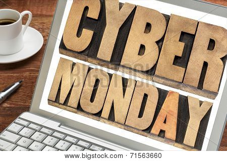 Cyber Monday - online shopping and marketing concept -  text in letterpress wood type blocks on a laptop with a cup of coffee