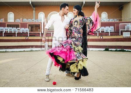 Couple, Models Of Fashion, In A Bullring
