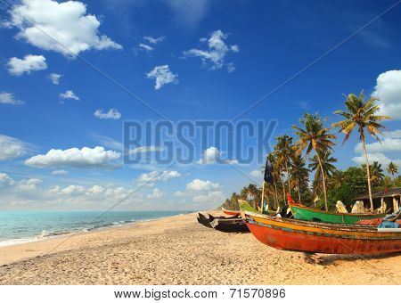 old fishing boats on beach - kerala india