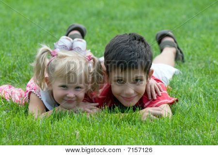 Smiling Little Friends At The Park