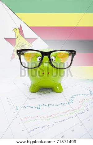 Piggy Bank With Flag On Background - Zimbabwe