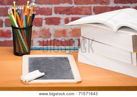 Desk With School Supplies And Slate