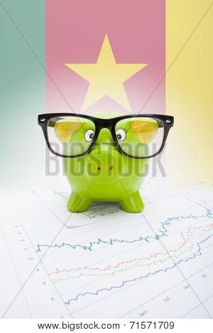 Piggy Bank With Flag On Background - Cameroon