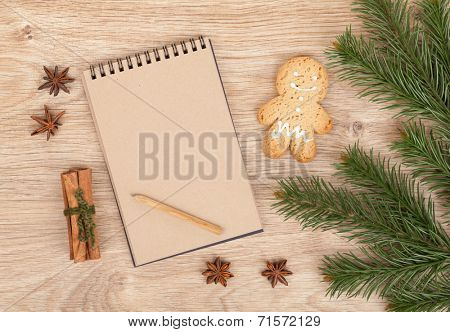 Christmas fir tree, gingerbrean man and blank notepad for copy space