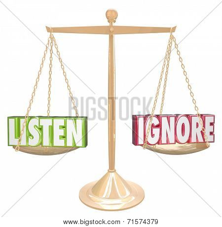 Listen and Ignore words in 3d letters on a gold metal scale or balance weighing options to pay attention or avoid listening to a person or group