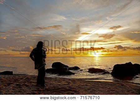 Sillhouette Of A Saxophonist At Beach