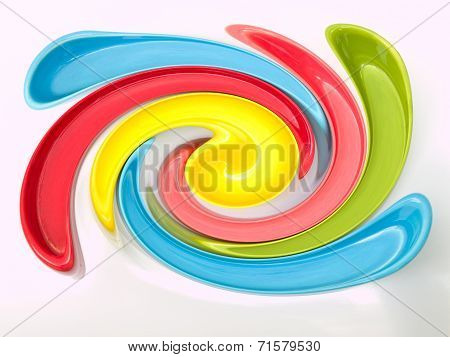Light blue green yellow and pink twirling stripes abstract background