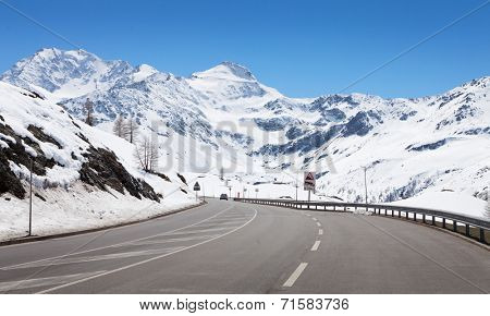 Mountain road in a sunny day (Swiss alps).  Simplon Pass, Valais, Switzerland