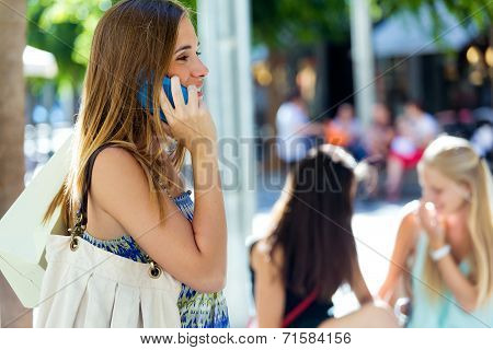 Beautiful Young Girl Talking On Mobile Phone In The Street.