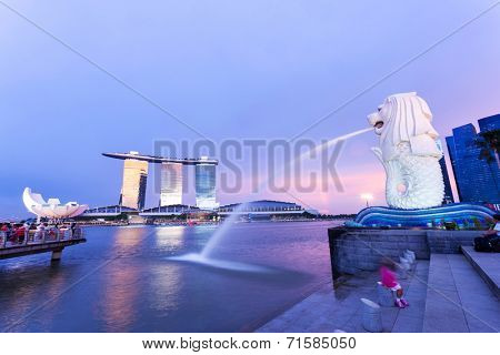 SINGAPORE-JUNE 30:The Merlion fountain June 30, 2014 in Singapore.Merlion is a mythical creature with the head of a lion and the body of a fish,and is a symbol of Singapore.