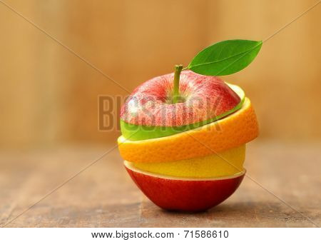 fresh stapled fruit on grunge wooden background.
