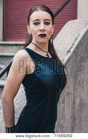 Pretty Goth Girl Posing In Urban Landscape