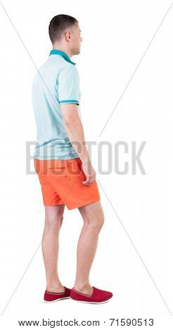 Back view of going  handsome man in shorts.  walking young guy . Rear view people collection.  backside view of person.  Isolated over white background.