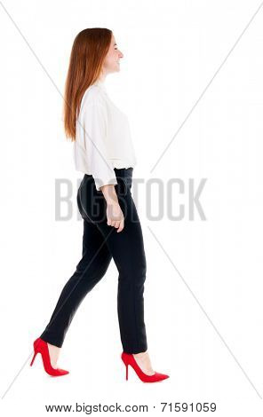 walking redhead business woman. back view. going young girl in  suit. Rear view people collection.  back side view of person.  Isolated over white background.