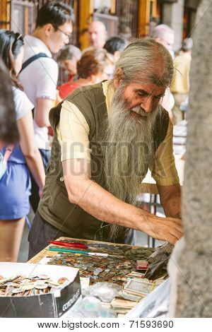 People At The Collectible Market Of Stamps And Coins In Plaza Mayor, One Of The Most Traditional Mad