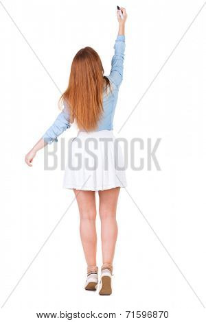 back view of writing beautiful redhead woman. Young girl in dress draws. Rear view people collection. backside view of person. Isolated over white background