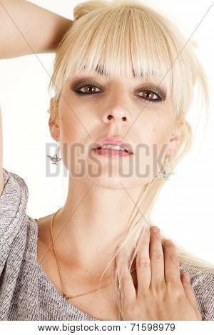 Woman With A Serious Expression Wearing Genie Bottle