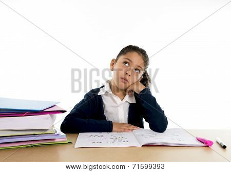 sweet cute school girl Bored Under Stress With A Tired Face Expression in hate studying concept
