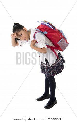 Spanish Sweet Little School Girl Carrying Very Heavy Backpack Or Schoolbag Full