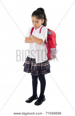 Sweet Moody Little Latin School Girl With Folded Arms And Schoolbag Standing Upset