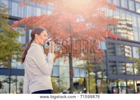 Urban Woman Sipping Coffee In To Go Cup