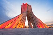 image of tehran  - Azadi tower at illuminated sunset - JPG