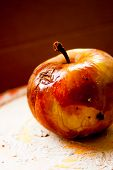 picture of rotten  - Red Rotten apple on a clay surface  - JPG
