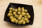foto of marinade  - Marinaded olives in a black square plate - JPG