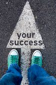 stock photo of snickers  - Green shoes standing on your success sign - JPG