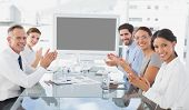 stock photo of applause  - Business colleagues giving applause in a meeting - JPG