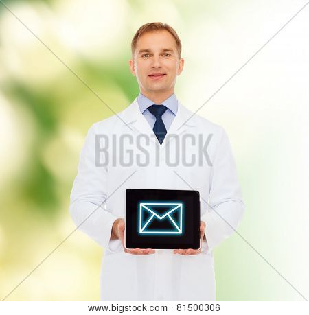 medicine, profession, and healthcare concept - smiling male doctor showing tablet pc computer screen over natural background