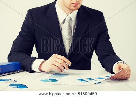 picture of businessman working and signing with papers