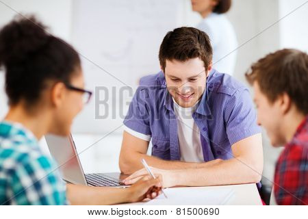 education concept - group of students studying at school