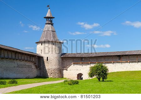 Stone Tower And Walls With Wooden Roofs Of Old Fortress