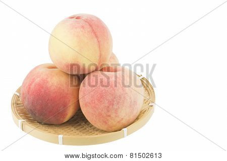 Peaches on bamboo basket