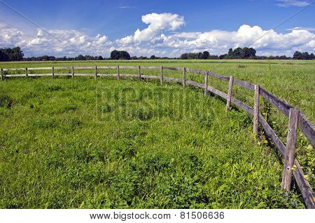 Farmland Landscape With Wooden Fence